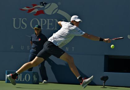 John Isner plays against Xavier Malisse 2012 US Open