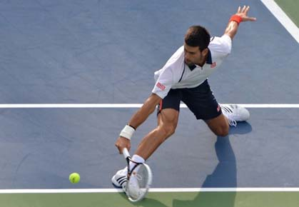 Novak Djokovic playing against David Ferrer on the first day of their two-day semifinal at the 2012 US Open