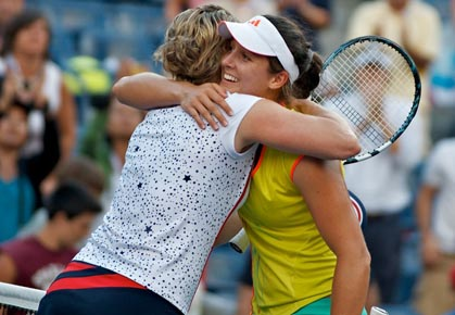 Laura Robson hugs Kim Clijsters after the Belgian retires from the WTA Tour