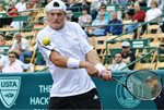Evgeny Korolev backhand - 2009 Clay Court - Houston, Texas