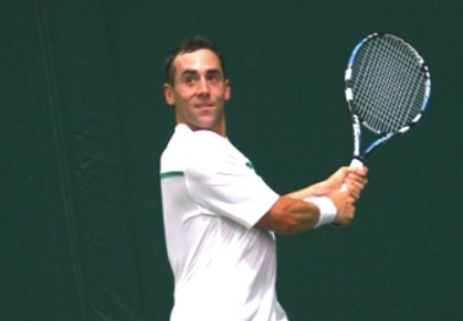 Bobby Reynolds of the United States hits a backhand during a match at the 2011 US Open Wildcard Playoffs.