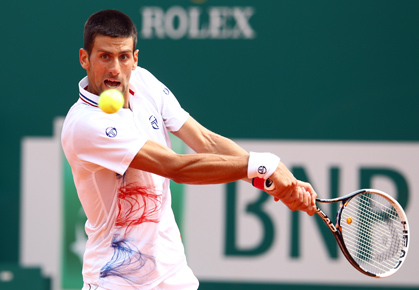 Novak Djokovic hits a backhand in Monte-Carlo