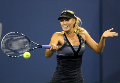 Maria Sharapova of Russia returns a shot against Anastasiya Yakimova of Belarus during Day Three of the 2011 US Open at the USTA Billie Jean King National Tennis Center on August 31, 2011 in the Flushing neighborhood of the Queens borough of New York City. (Photo by Nick Laham/Getty Images)