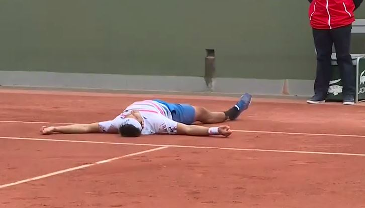 Video: Matosevic Ends Run of Grand Slam Ineptitude and Rolls in the Dirt to Celebrate
