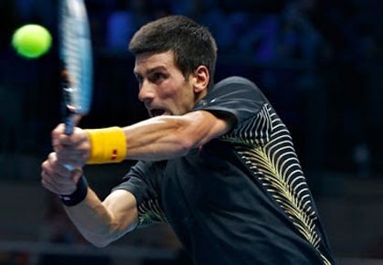 Novak Djokovic wins his Group A match against Andy Murray
