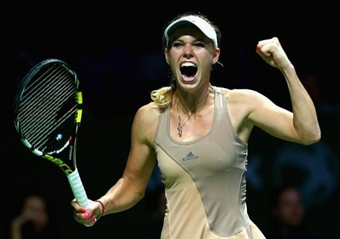 Wozniacki Outlasts Sharapova in Three-Set Thriller
