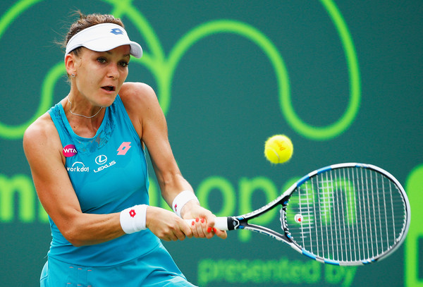 Radwanska Surges Past Hingis in Fed Cup