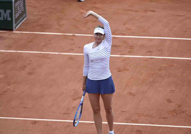 Sharapova Sweeps Stosur to Reach RG Fourth Round