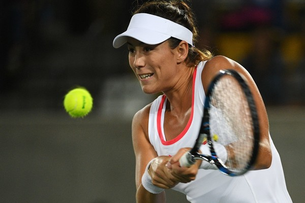 Muguruza Battles Back Against Mertens in Opening Round