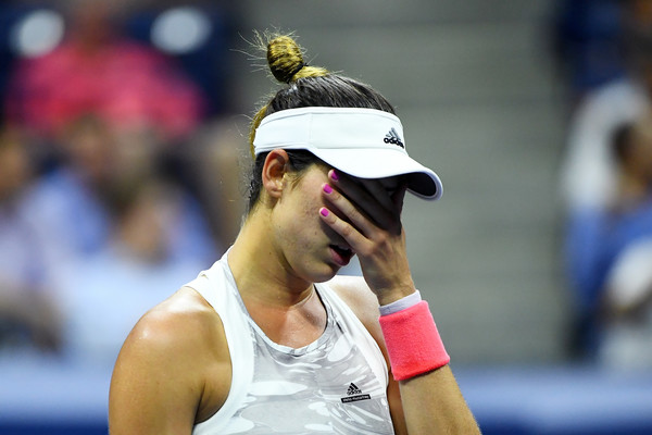 Muguruza Crashes Out to Sevastova in Flat Performance